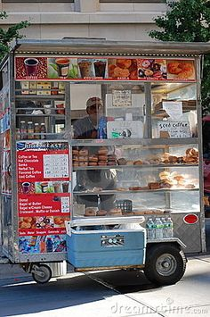 """On the sidewalk in front of our motherhouse on West 59th Street in New York City sits one of Gotham's ubiquitous coffee carts.  Paulist Fr. John Collins has gotten to know the """"guys in the cart.""""  This photo links to his reflection on them and their faith."""