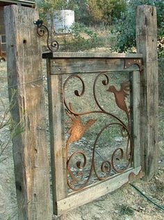 Beautiful DIY gate made with metal scroll work. Simple and stunning; garden and yard art, gate, fence