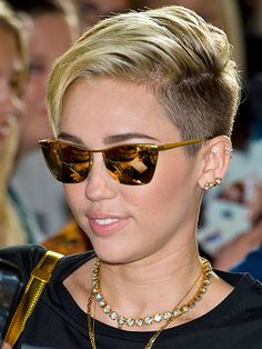 This former Disney princess has a new signature 'do, and 'tude that goes with it! #undercut #halfshavedhead #MileyCyrus