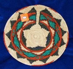 """A large finely handwoven basket that measures 14"""" dia x 2.5"""" depth. Classic southwestern design. Similar in quality to those made by the Native American's of the southwest. $24.95 #basket #handwoven #southwestern #homedecor"""
