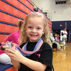 Addie Miller won a medal in the Lil' Dragons competition at Spar Wars in Dickson, TN, Sept. 29, 2012.