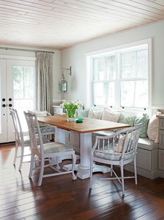 Addition dining room inspiration. Planked ceiling.  Mixed chairs.  Pillows. But with more windows