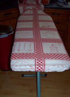 Using my burned nasty old ironing board cover, I cut the elastic and tight-lock under attachments off and sewed it to fabric that matches a tablecloth, etc in my retro red and white kitchen. While replacing one with just string might be easier, I found I could put rough edges under the sew line and used duct tape to conceal them. Now I have all the advantages of an elastic cover with under fasteners with the old cover serving as padding beneath.