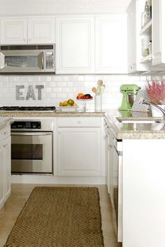 Kitchen counter decor - Kitchenaid on the counter & cake stands with fruit or candles when not in use