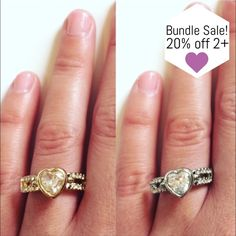 Pretty Cubic Zirconia Heart Ring Gorgeous sparkly cubic zirconia ring! Pretty heart and stones design. Available in gold or silver. One size, adjustable.  [BUNDLE] for 15% off!  ❌No trades, PayPal, Holds 📷Instagram: @lovelionessie Jewelry Rings