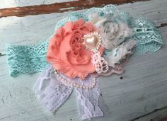 Soft light coral and aqua blue mint shabby fabric flowers embellished with a heart pearl rhinestone and ruffled lace. Measures approximately 4 across. **CUSTOM MADE for you similar to the one shown here. **PRODUCTION TIME: approximately 1-2 weeks *Production Time is before shipping. U.S. Residents should expect to receive their order no later than 3rd week from purchase date. *HEADBAND COLOR OPTIONS: Light Coral, Aqua, White and Ivory.  ** If you have a color preference, please specify…