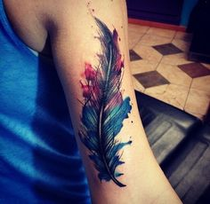 A watercolor feather tattoo with darker colors--me like!