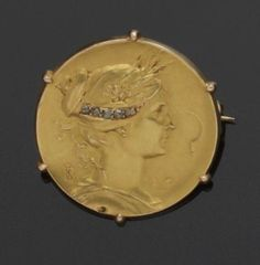 A French Art Nouveau gold and diamond medallist brooch