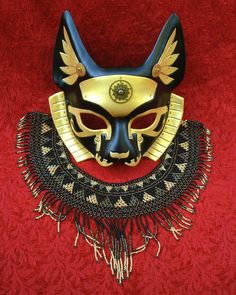 This is a fanciful rabbit mask done in the Venetian style. However, unlike a true Venetian mask (which is made of lightweight leather that is embellished with plaster and precious metal leaf, and i...