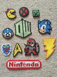 http://www.ebay.com/itm/Perler-Bead-Pixel-Art-Geek-Lot-11-Magnets-MEGA-MAN-NINTENDO-DOCTOR-WHO-/222030849045?hash=item33b211e415:g:NI0AAOSwezVWuA0X