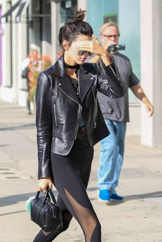 Kendall Jenner in mesh cut out leggings and leather moto jacket goals