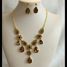 Elegant jewelry set. Jewelry set with brown rhinestones and gold toned chain. Jewelry Necklaces