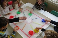 Color Ice Hockey by Teach Preschool.  I love this!  It's just a big tub with tape on the bottom, filled with water and left to freeze over outside overnight.  The kids can play with it however they like.  What fun!