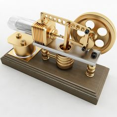 Always wanted one of these for my man room. Robinson Stirling Engine Model