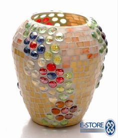 vase love the mix of round nuggets & square tile