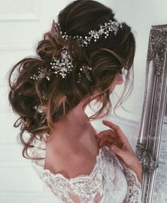 Gorgeous white hairpiece messy wavy low updo wedding hairstyle; Featured Hairstyle: Ulyana Aster