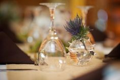 Interesting vase... but I like the thistle looking part. Floral by Petal & Kettle, Photo by Gucio Photography