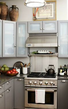 Suzie: Emily Johnston Anderson - Glossy gray lacquer top kitchen cabinets with frosted glass ...
