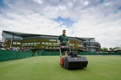 Preparing for The Championships  A groundsman cuts the grass on Court 6 ahead of the Championships. - AELTC/Matthias Hangst