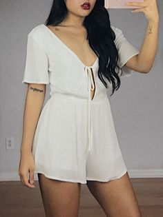 Short flutter sleeve tie front fitted waist romper 100% Polyester Made in USA Pictured : Size Small