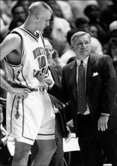Dean Smith is pictured with Eric Montross in the early 1990s. Photo from the University Gazette at UNC.