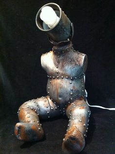 Industrial Steampunk Baby Mannequin Lamp desk lamp night by kyoob. Creepy and weird in a way that appeals to me. Kinda wish there was something where the arms were, like antennas or knobs, but that's just personal preference.