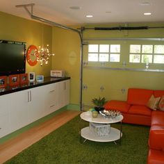 Garage converted to living space for a kids' playroom or entertaining area. Uses original garage door.