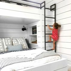 Big kid bed below, little's bunk loft above