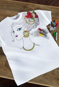 Take your coloring off the page with this beautiful colored t-shirt. Follow the pattern or create a design of your own.