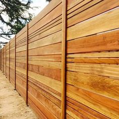 Boxed steel posts... Custom cap w/ redwood hillndale boards.. Lattice doubled up.. Stained redwood natural tone ... - Yelp