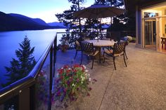 STUNNING VIEWS - Just imagine enjoying a glass of wine while looking out while the sun sets | Sprout Lake, Port Alberni #Waterviews #Luxury