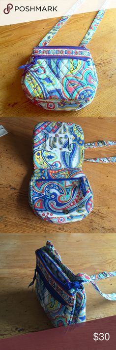 Vera Bradley purse Cross body purse with two pouches on the top (one with zipper and the other with magnetic clasp), front zipper pouch and another zipper pouch under front flap with place for cards and ID Vera Bradley Bags Crossbody Bags