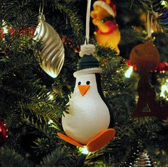 So cute! A penguin ornament made from a lightbulb! https://www.retailpackaging.com/categories/74-everyday-specialty-ribbon #christmas #holidays #decor #DIY #crafts