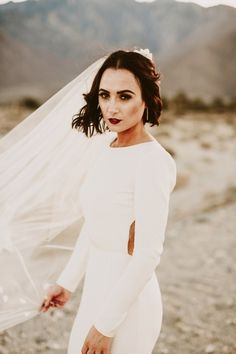 Moody make-up, trailing veil, and backless, long-sleeved bridal style | Image by Lauren Scotti Photography
