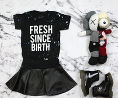 Dr. Martins, a black skater skirt, and a t-shirt is totally cute and if you want to add something's special it would be a stuffed animal or you know some long knee socks
