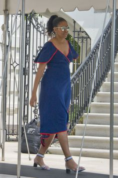 FLOTUS Michelle Obama on vacation in Martha's Vineyard wearing a Tory Burch dress and Fendi sandals.