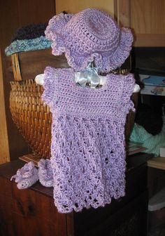 Ravelry: Baby Dress with Solomon's Knot Skirt free pattern by Jessica Lombard