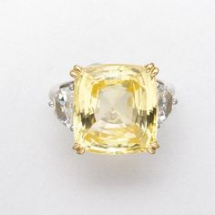 K GOLD, YELLOW SAPPHIRE AND DIAMOND RING