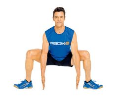 P90X: The Jack Squat. Start in a wide squat with toes out, arms down, fingertips touching floor (as shown). Remain in squat and jump feet together as you clap hands overhead. Jump back to start, staying low. Go for 1 minute. #SELFmagazine