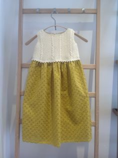 Two of our favourite colours, our classic dress hand knitted in cream organic cotton and a mustard gold broderie skirt available from Ocean Drive Living Winchester.