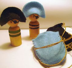 little wooden pirates - couldn't we make these with clothespins, markers or/paint, and some felt?  too fun!