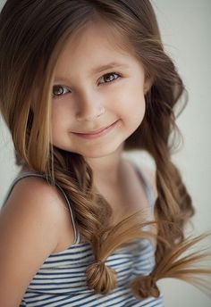 I don't know what's more adorable, the girl or the hair! :)