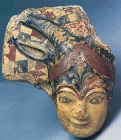 The divine protectress Juno Sospita, molded in terracotta and painted in vibrant red and black, once smiled from the roof of an early-fifth-century B.C. Etruscan temple. Worshiped throughout central Italy as a guardian of cities, the deity wears her characteristic colorful helmet, with checkered crest, goat ears and horns (one of each is missing), and stylized palm branch.