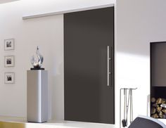 antracite color sliding wood door with tvin sliding system