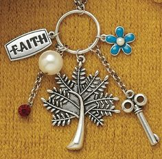 """28"""" Faith Necklace.  Meaning behind each charm: Tree - Family Tree Pearl - Pearl of Great Price Ruby - The price of a virtuous woman is said to be """"far above rubies"""" (Prov. 31:10) Flower - Forget me Not Key - Key to your heart"""