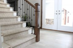 "Flooring: Coretec Plus, Ivory Coast Oak, 7""x48""; Staircase Carpet: Soaring Design, Bay Mist"