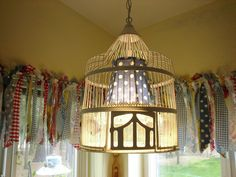 I love the ribbons or fabric scraps on the window (from The Cutest Cottage Lamps Etc.)