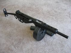 A Mk II Sten gun (home built from a parts kit) modified to accept a drum magazine from a Finnish Suomi KP/-31 submachine gun. The Sten gun's simplicity meant it could be mass produced quickly and cheaply, and by the end of World War Two it cost less than $10 to manufacture one. It can also be made as a DIY project, using mail order parts and a dremel tool.