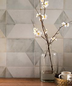 Geomento™ http://www.toppstiles.co.uk/tprod46992/geomento-tile.html Inspirited by 1930's Art Deco, Geomento downplays harsh architectural lines with blurred pastels and a five pattern variation that creates a sinuous pattern on either the wall or floor.