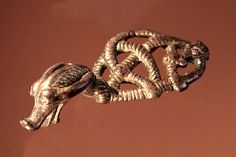 Dragon made in bronze. Dated to the Viking period (AD 800-1050). Width 3,5 cm. Uppåkra, Sweden. (Photography by Bengt Almgren, LUHM)